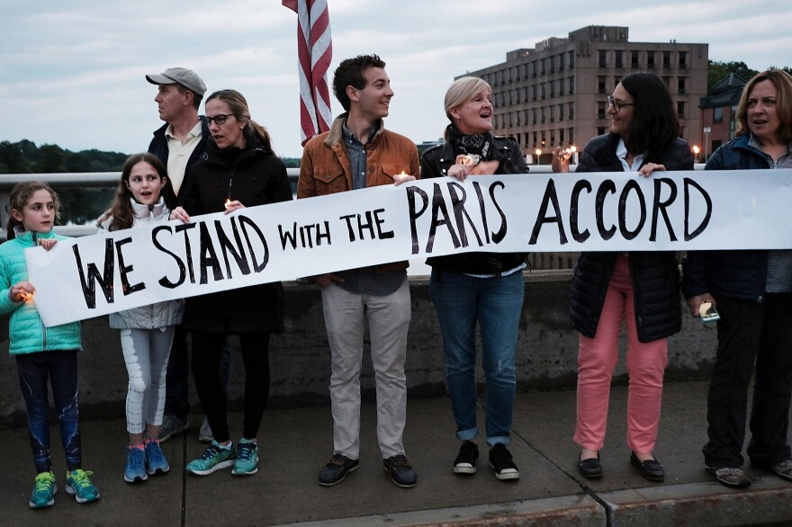 Connecticut residents at a rally for the environment against President Donald Trump's decision to withdraw the U.S. from the Paris climate accord. Connecticut is one of twelve states and Puerto Rico that formed the U.S. Climate Alliance, all committing to uphold the Paris Accord.