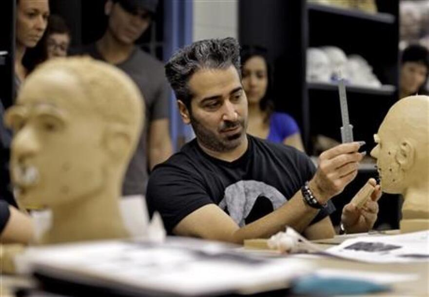 Forensic artist Joe Mullins of the National Center for Missing and Exploited Children works with fellow artists on facial reconstructions at the University of South Florida in Tampa, Fla.