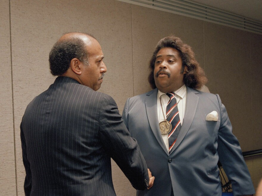 Hastings, left, shakes the hand of Rev. Al Sharpton in July 1989, the year Hastings was impeached and removed from the federal bench by Congress. Now, he is helping write the rules for the impeachment vote of President Trump.