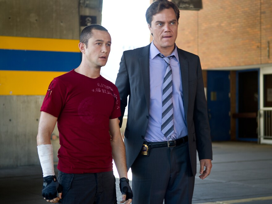 Officer Bobby Monday (Michael Shannon) is interested in what Wilee is carrying.