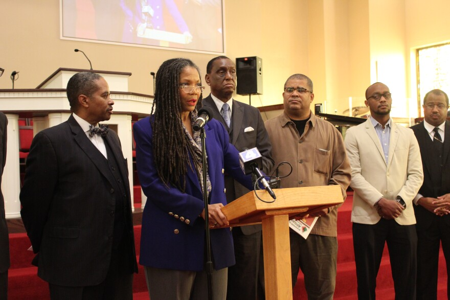 The Rev. Dinah Tatman and faith leaders speak in support of the economic boycott on Nov. 2, 2017.