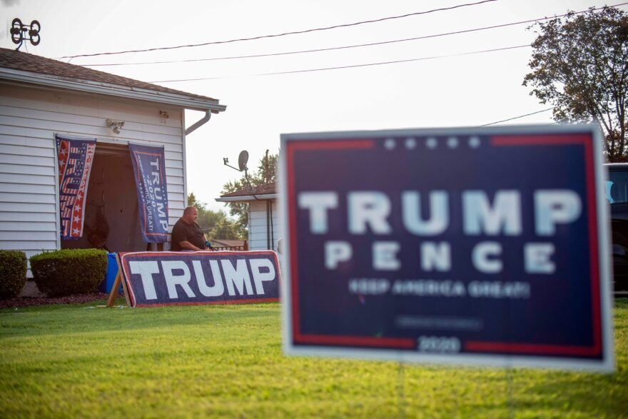 """Former Democratic party voter and now fervent Trump supporter David Mitchko speaks during an interview with AFP outside his home covered with """"Trump-Pence"""" banners in Olyphant, just outside Scranton, Pennsylvania."""