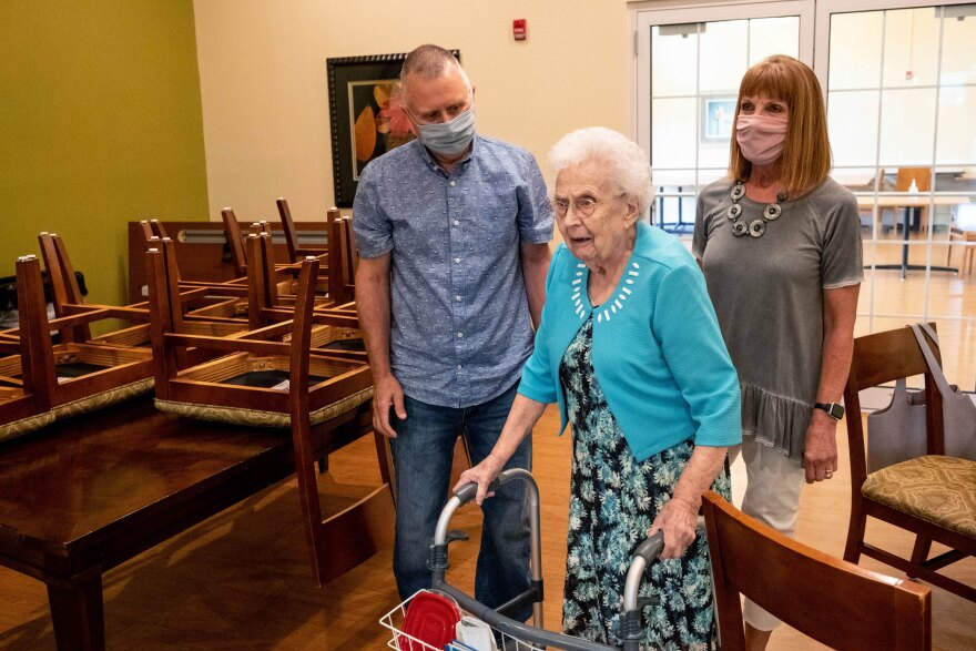 Mark and Janet Shaver assist Betty Shaver, 96, back to the door at the Mapleshire Nursing and Rehabilitation Center in Morgantown, W.Va.