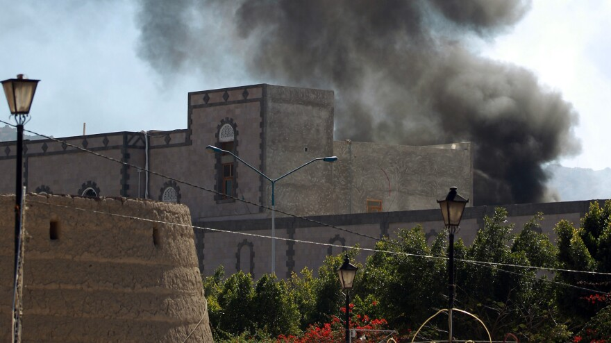 Smoke rises from the site of a suicide car bombing at the Defense Ministry in Sanaa, the Yemeni capital, Thursday.