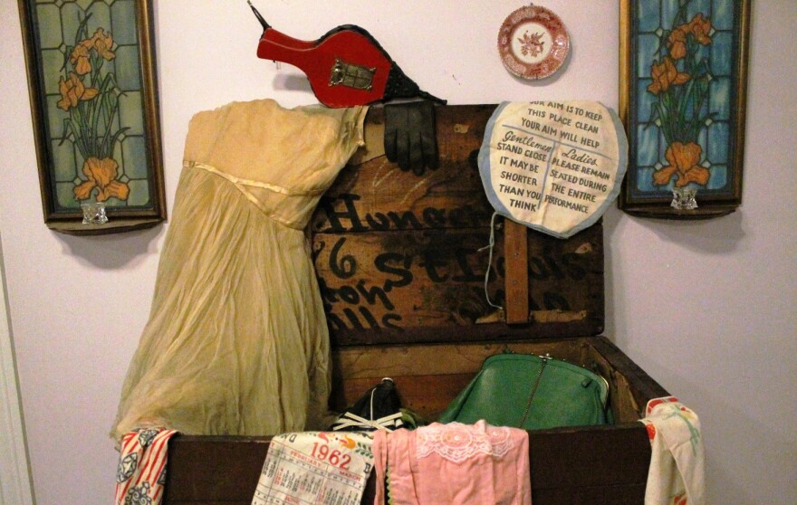 Lois Conley found these items inside this trunk in a home lost to eminent domain for the NGA project. She imagines the dress could have been for a prom or even a bride.
