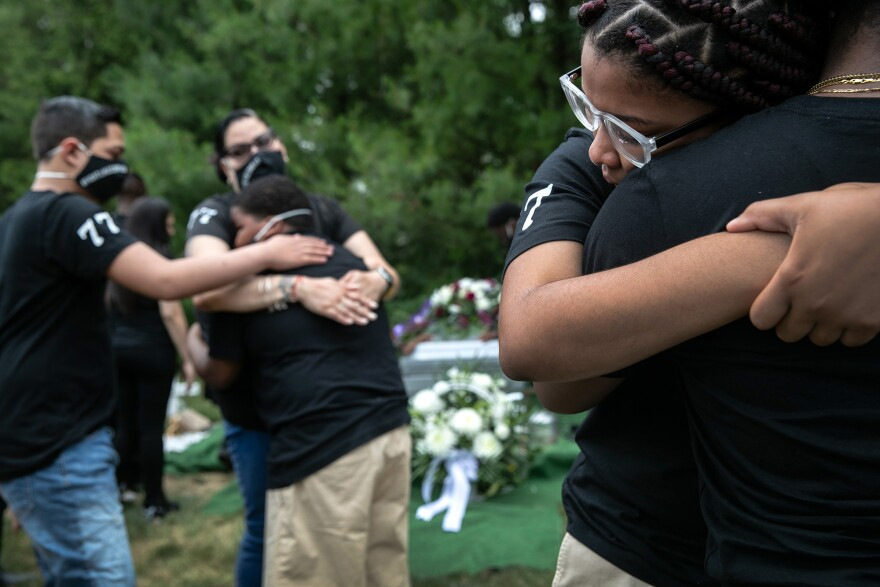 Family members mourn the death of Conrad Coleman Jr. at his burial on July 3, in Rye, N.Y. Coleman, 39, died of Covid-19 on June 20, just over two months after his father Conrad Coleman Sr. also died of the disease.
