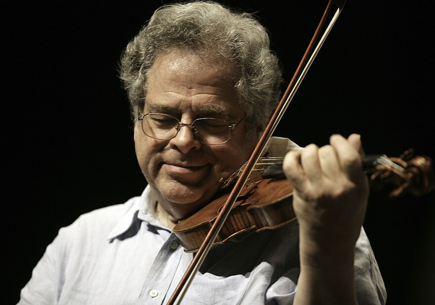 Itzhak Perlman plays his 1714 Soil Stradivarius violin in rehearsal with the East Texas Symphony Orchestra, at the University of Texas at Tyler, on April 4, 2009.