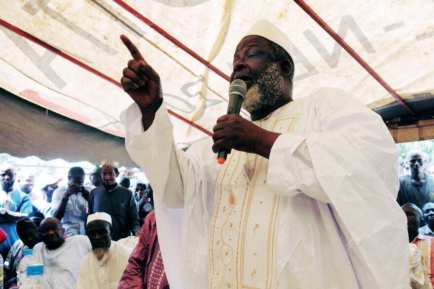"""Guinea's Grand Imam, El Hadj Mamadou Saliou Camara, tells his fellow clerics: """"If there is any doubt at all, then no one must touch the body."""""""