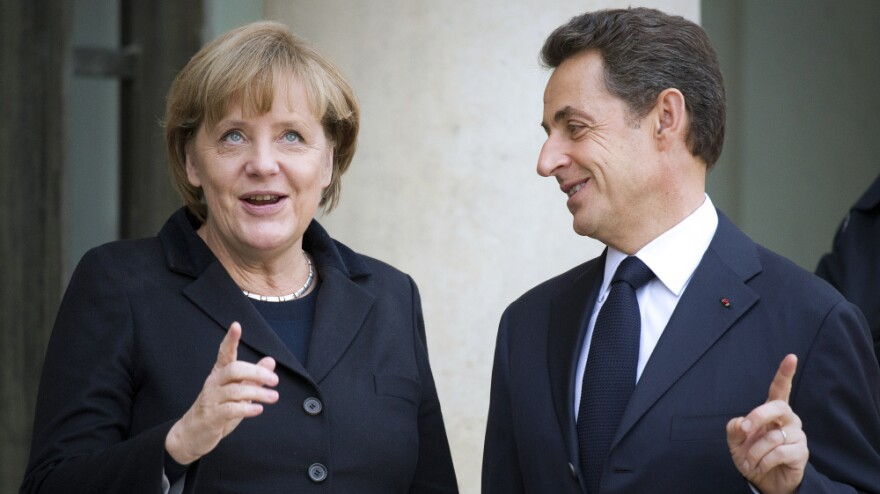 French President Nicolas Sarkozy and German Chancellor Angela Merkel in Paris today (Dec. 5, 2011).