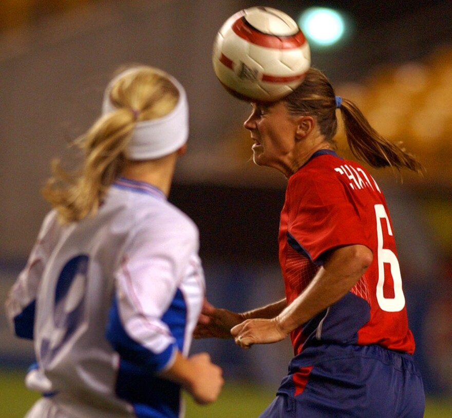 U.S. soccer player Brandi Chastain clears the ball during a friendly match against Iceland in 2004.
