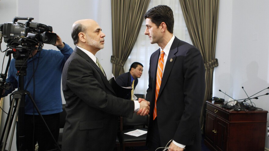House Budget Committee Chairman Paul Ryan, R-Wis., shakes hands with Federal Reserve Chairman Ben Bernanke at the close of the committee's hearing on the state of the economy in February 2011.
