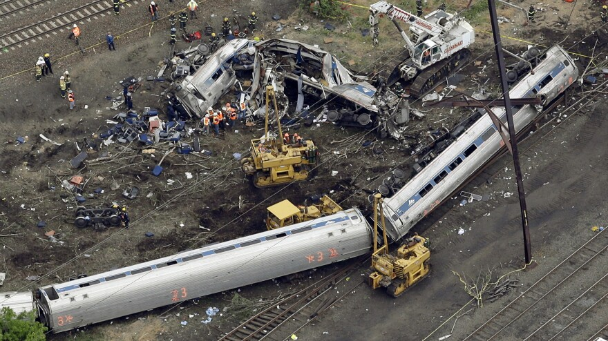 Emergency personnel work around the train that derailed in Philadelphia in 2015. The city District Attorney's Office said Tuesday that the engineer involved in the crash, which killed eight people and injured some 200 others, will not face charges.