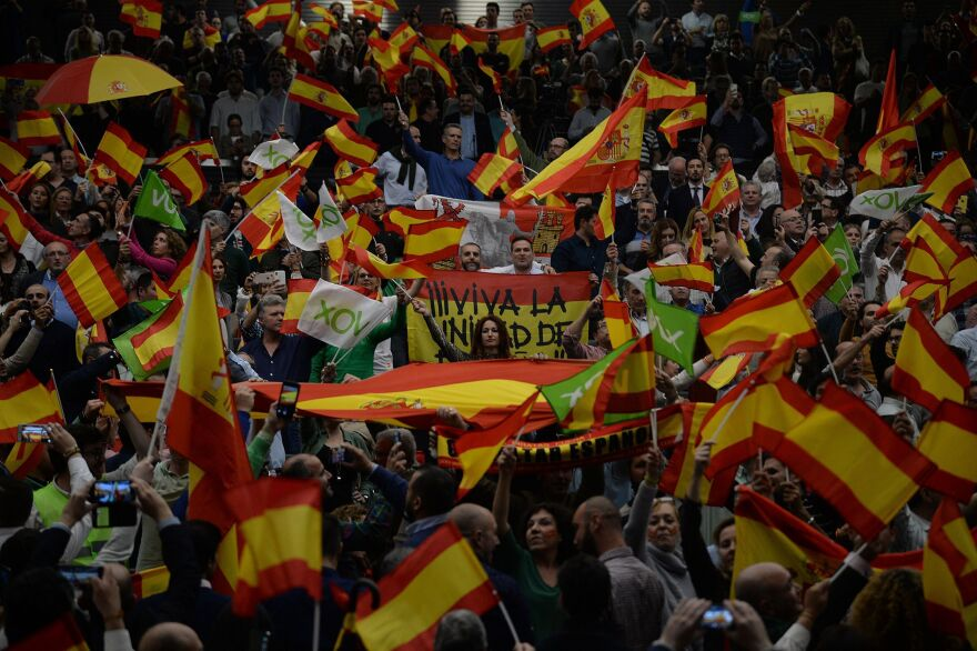 Far-right party Vox supporters wave Spanish flags during a campaign rally in Seville, Spain, on Wednesday, ahead of Sunday's general election.