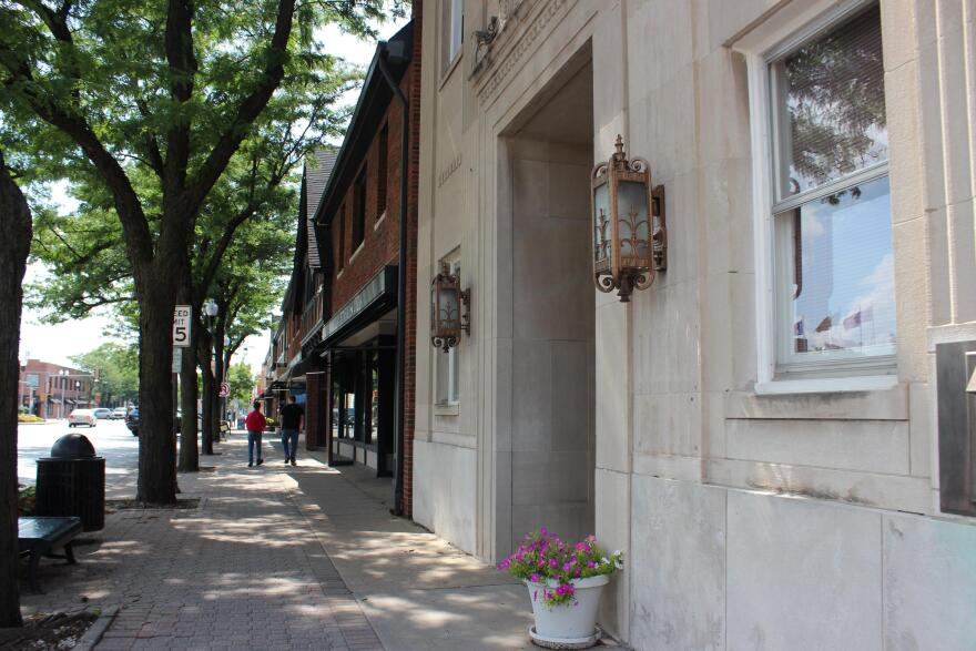 Buildings and people on the sidewalk, North KC downtown_kcur_caroline kull.jpg