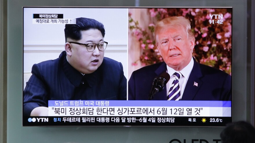 A TV screen in the Seoul Railway Station in Seoul, South Korea shows file footage of U.S. President Donald Trump, right, and North Korean leader Kim Jong Un during a news program on Saturday, May 26, 2018.