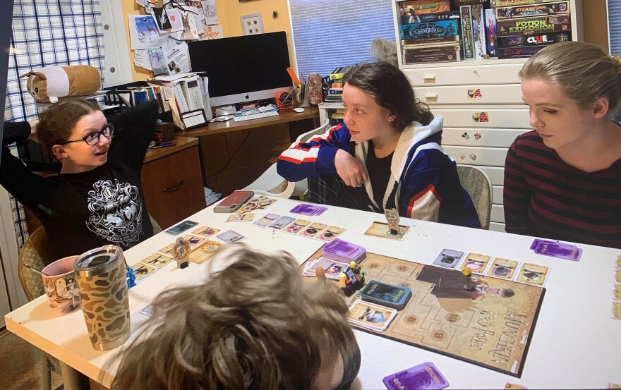 (left clockwise) Daisy, Evie, Claire and Xylon Mason play a board game together at their home in Charles Town, W.Va. Games have been a major key to learning for the Mason children who are all homeschooled.