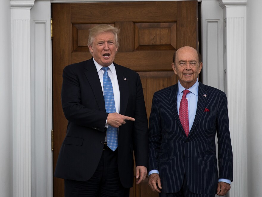 Shortly after winning the 2016 election, Donald Trump asked investor Ross to be his commerce secretary. The pair are pictured here at Trump's golf club in Bedminster, N.J., in November 2016.
