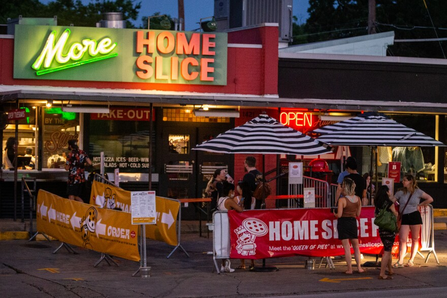 Customers line up to order at Home Slice Pizza on South Congress.