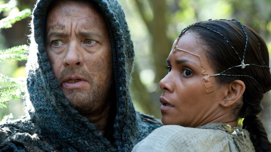 Zachry and Meronym are only two of the combined 12 characters Tom Hanks and Halle Berry play in<em> Cloud Atlas</em>. It is a challenge that bests both actors, according to David Edelstein.