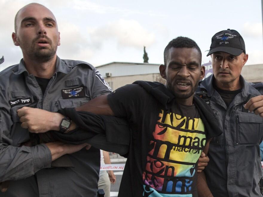 Israeli police officers detain an Ethiopian-Israeli during a demonstration Sunday in Tel Aviv.