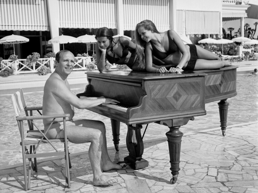 A shot of jazz pianist Claude Bolling and friends, taken on a beach in Cannes, France in 1969.