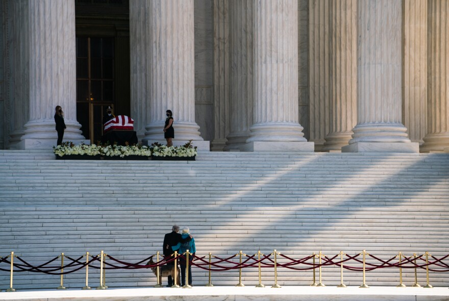 People pay their respects as Justice Ruth Bader Ginsburg oies in repose at the US Supreme Court.