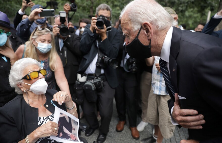 Democratic presidential candidate Joe Biden greets Maria Fisher, 90, whose son Andrew Fisher was killed in the World Trade Center's north tower 19 years ago.