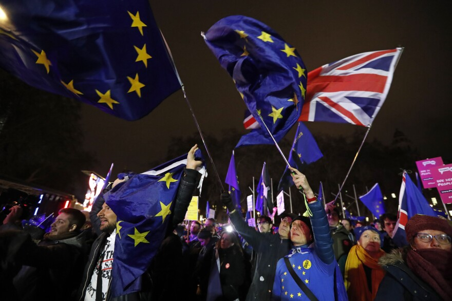 Anti-Brexit demonstrators react after the results of the vote on British Prime Minister Theresa May's Brexit deal were announced in Parliament square in London on Tuesday. British lawmakers have rejected the deal by a huge margin, plunging U.K. politics into crisis 10 weeks before the country is due to leave the European Union.