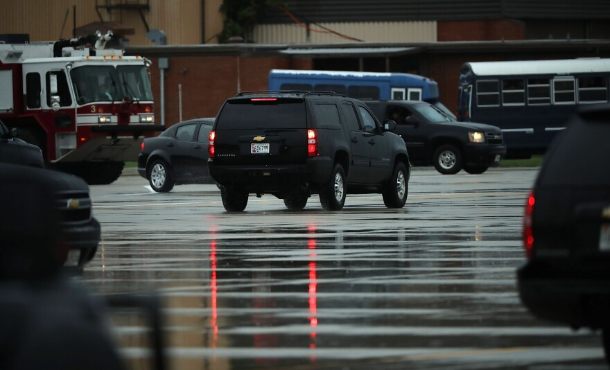 The vehicle carrying outgoing White House chief of staff Reince Priebus leaves ahead of the presidential motorcade on Friday in Joint Base Andrews, Md.