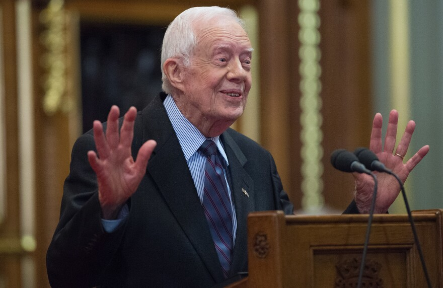 """Former President Jimmy Carter delivers a lecture on the eradication of the Guinea worm at London's House of Lords on Feb. 3. The lecture title: """"Final Days of the Fiery Serpent: Guinea Worm Eradication."""""""