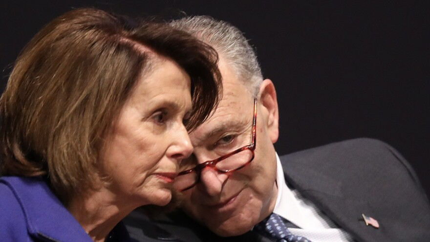 Senate Minority Leader Chuck Schumer, D-N.Y.,speaks with House Minority Leader Nancy Pelosi, D-Calif., during a ceremony at the U.S. Capitol in November 2017.