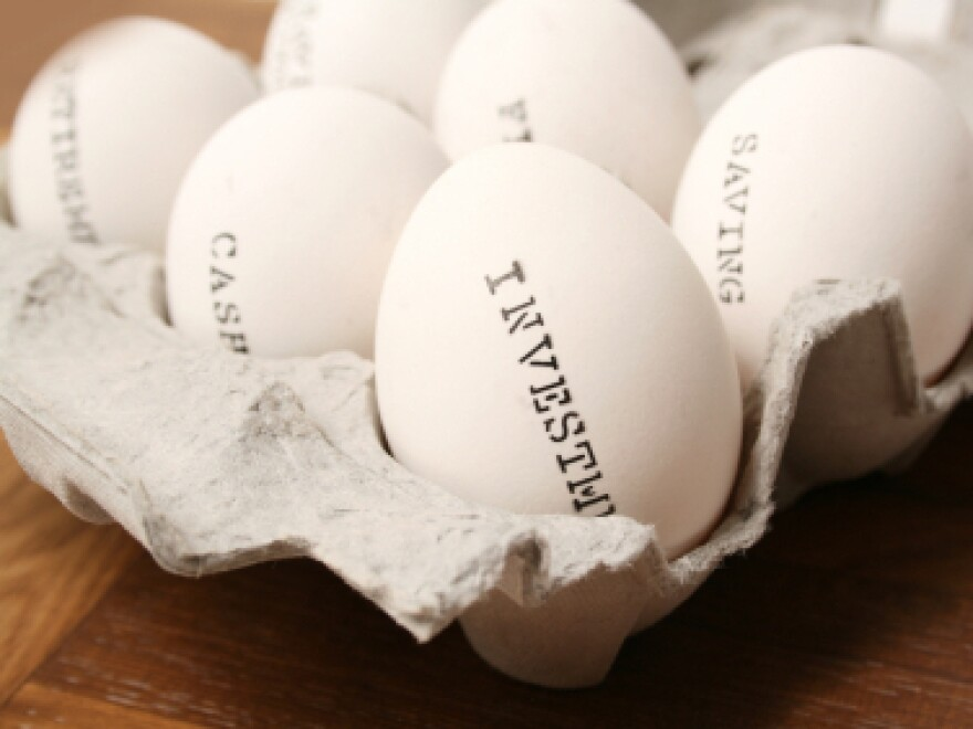 Eggs labeled as cash, investments and savings.