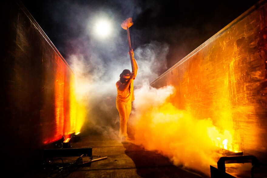 Thor Harris bangs a dumpster as part of a socially distant musical performance held at dadaLab event space.