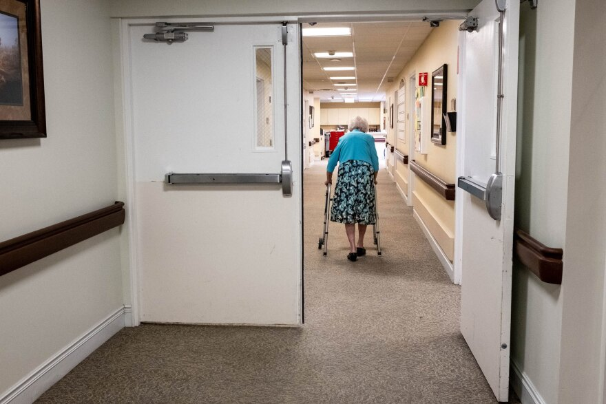 Betty Shaver returns to her room after a visit with her family.
