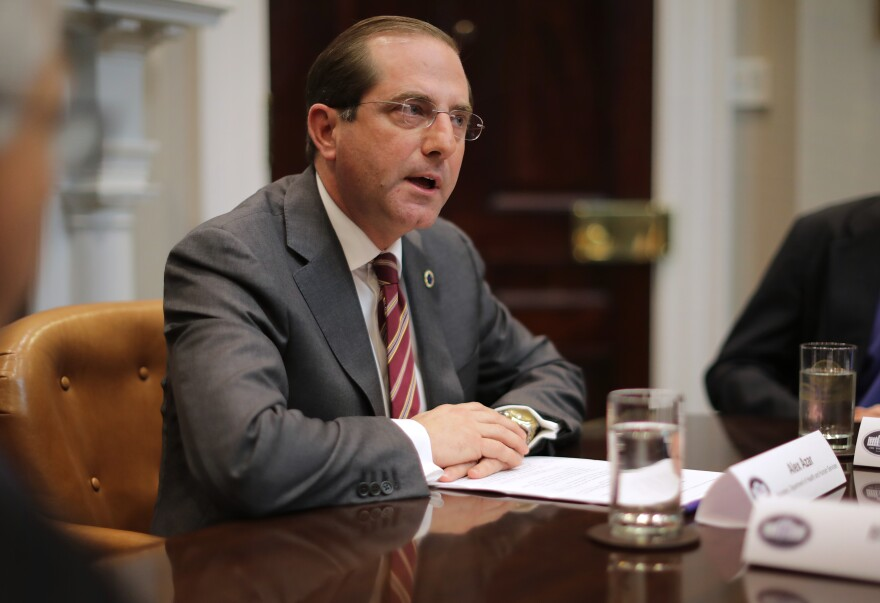 "HHS Secretary Alex Azar at a White House roundtable discussion of health care prices in January. Azar tells NPR his office is now in ""active negotiations and discussion"" with drugmakers on how to make HIV prevention medicines more available and ""cost-effective."""