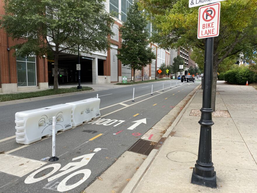 The Uptown Cycle Track pilot project outside the ImaginOn on Sixth Street.