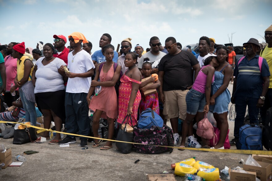 Hundreds wait at the port of Marsh Harbour in the hopes of boarding a boat to Nassau after the town on Abaco in the Bahamas was decimated by Hurricane Dorian.