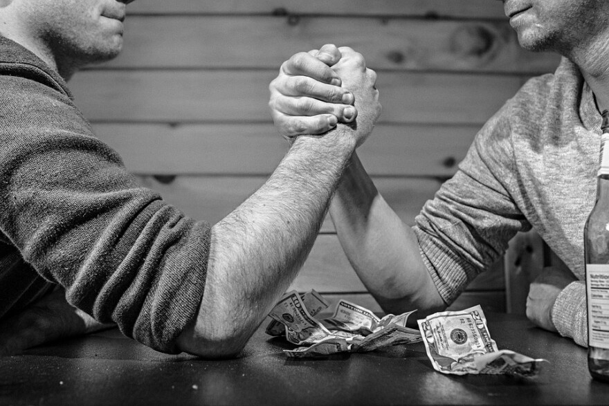 arm_wrestling_w_money_cash.jpg
