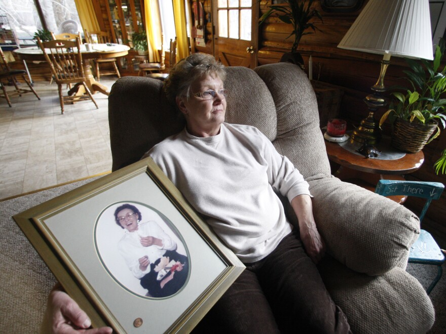 Gayla Benefield holds a portrait of her mother at her home in Libby, Montana.