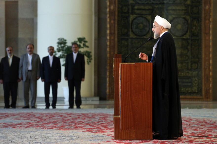 Iran's president Hassan Rouhani addresses the nation in a televised speech last July. He has condemned the attack on the Saudi Arabian Embassy in Tehran, but the episode gave the appearance that he's unable to keep hardliners in check.