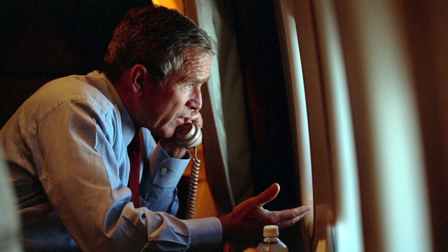 Then-President George W. Bush speaks to Vice President Dick Cheney by phone aboard Air Force One on Sept. 11, 2001.