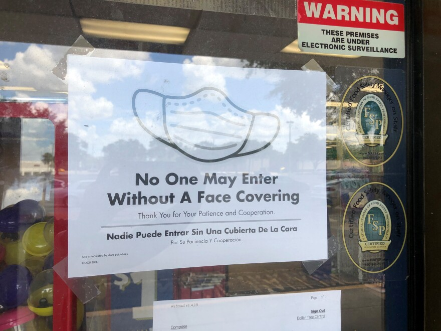 A sign at the Dollar Tree says no one is allowed to enter without a mask.