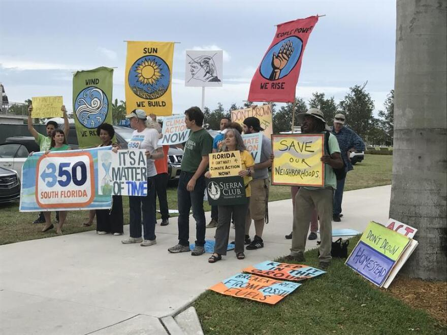 Protesters from several environment groups gathered in Miami's Museum Park last June, angered by President Donald Trump's decision to withdraw the United States from the Paris climate accords.