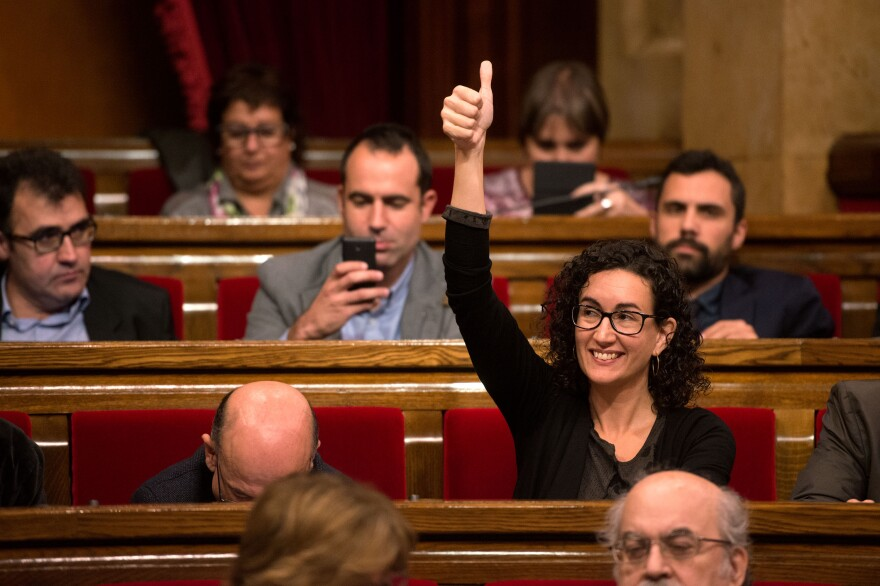 Junts Pel Si (Together for Yes) member of the Catalan Parliament Marta Rovira gives a thumbs up as she votes to pass the start of the independence process Monday in Barcelona, Spain.