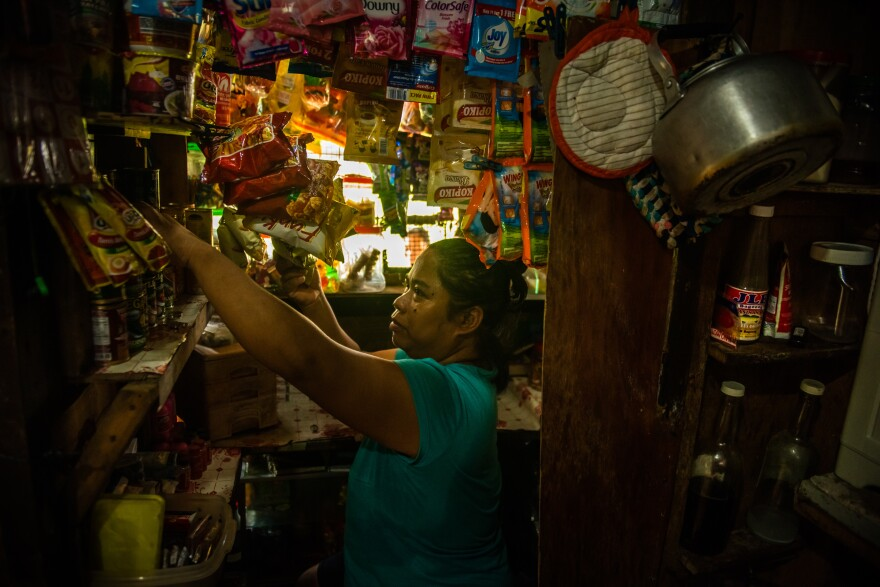 Nimfa Manlabe, 46, boosts her income by selling consumer goods in sachets from her <em>sari-sari</em> store in her home in Manila. This is a common way for Filipinos to get their daily supplies.