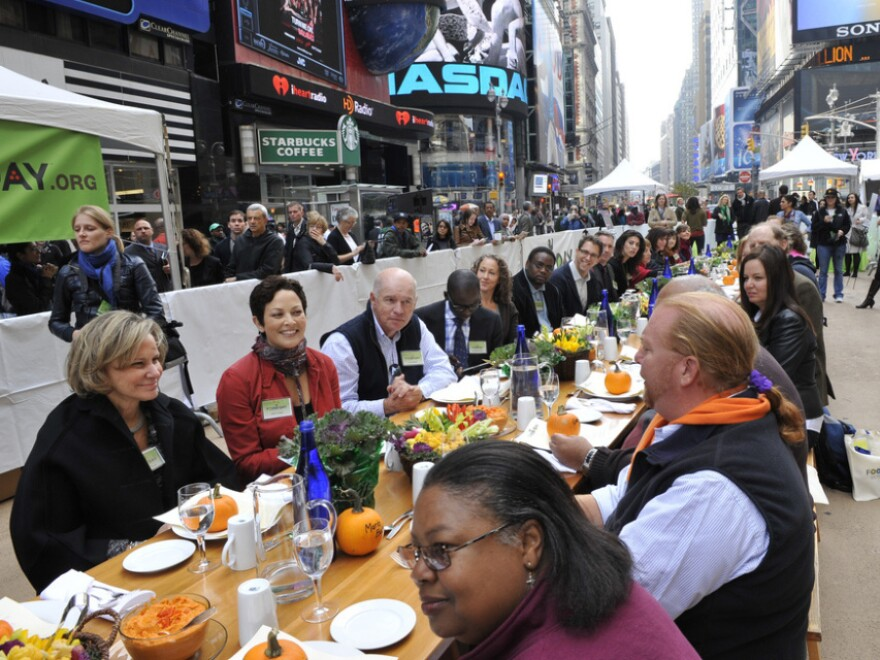 """<p>Participants, including Mario Batali, right, at the """"Eat In,"""" a Food Day lunch event in Times Square in New York on Monday. </p>"""