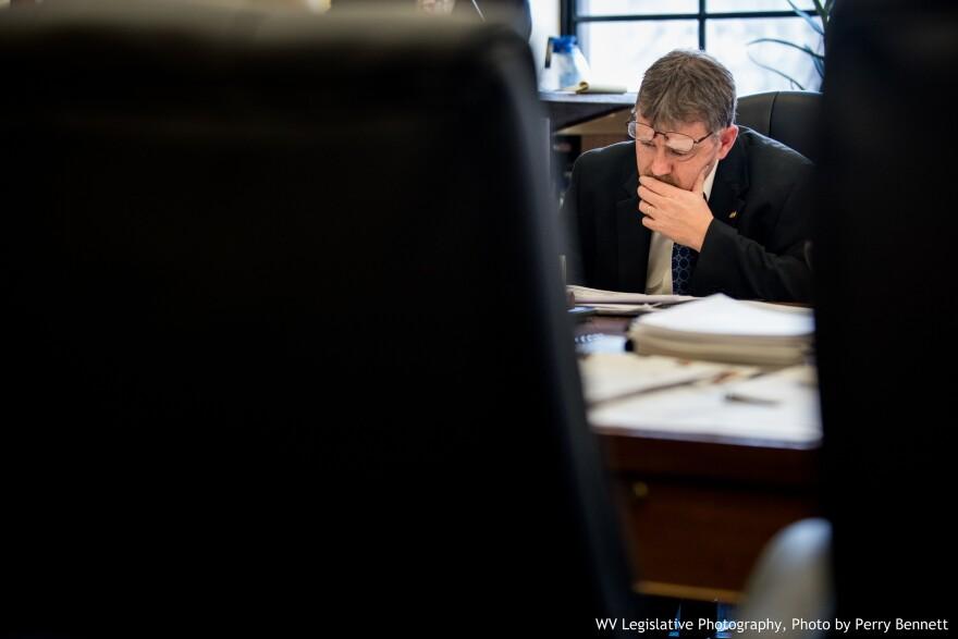 West Virginia House Majority Leader Daryl Cowles, R-Morgan, studies legislation in a House Finance Committee meeting in 2017.
