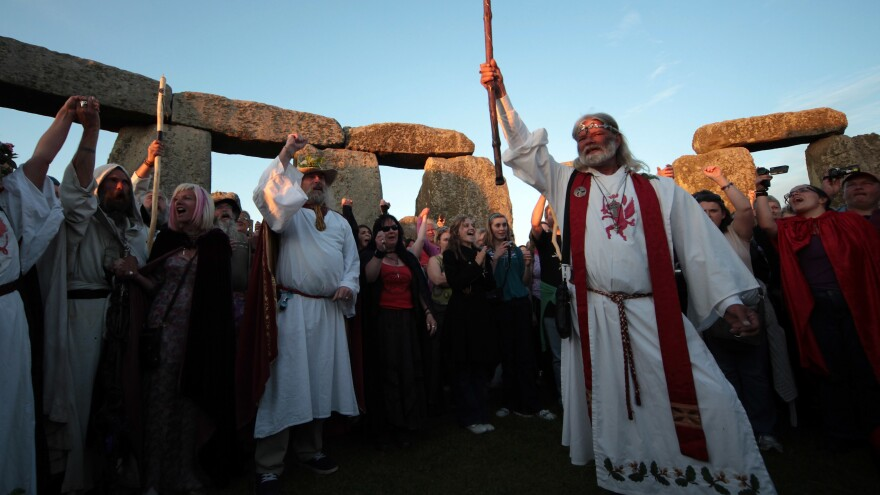 Druid King Arthur Pendragon, conducts a Solstice sunset service as people gather in the megalithic monument of Stonehenge in 2010.