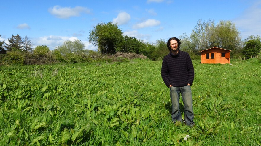 Paul Kingsnorth — seen here in front of his writing shed — used a crowdfunding platform to publish <em>The Wake</em> after mainstream houses didn't bite.