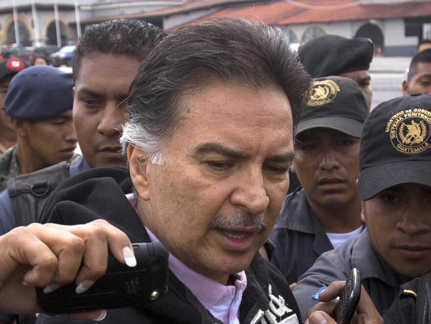 Former Guatemalan President Alfonso Portillo speaks with journalists in Guatemala City before boarding a plane for the U.S. on Friday.